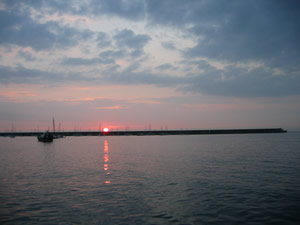 Sunset over Braye harbour, Alderney
