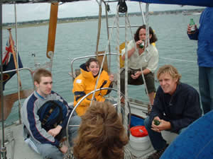 Fellow crew members and family have a few beers at the helm