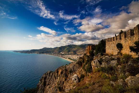 View across beach towards marina from castle