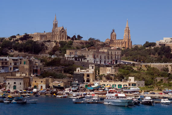 """If you had to choose 3 places to visit in Malta, what would they be? Also, is it worth taking a day trip to Gozo if you have only 3 days in which to see as much as possible?"""" These were the questions we texted to our parents when we arrived in Malta. Both lots put Gozo high on the list of places to visit, so who were we to argue?  We set off early-ish in order to drive across Malta from Manoel Island to the ferry port, giving ourselves plenty of time to see all the sites that I had carefully listed in the back of our newly acquired Lonely Planet guide. Gozo's only a small place, so I reckoned we could pack a lot in, especially with Jamie's recently perfected rally-style driving... We hadn't taken into account, however, the crap road map, the non existence of road signs on Malta and Gozo and the over-crowded roads in the morning rush hour. With somewhat shredded nerves we finally arrived at the ferry, missing it by one minute and having to wait 45 minutes for the next one. Nice start."""