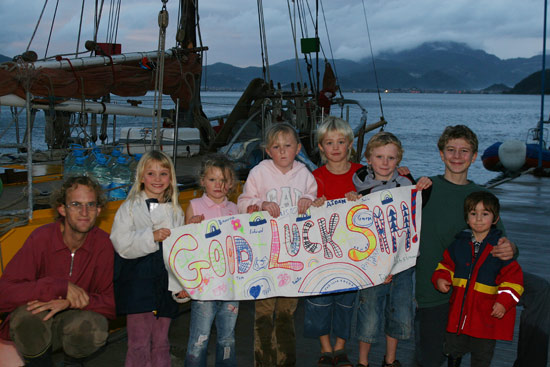 Sam is presented with a banner from the kids of Marmaris Yacht Marina