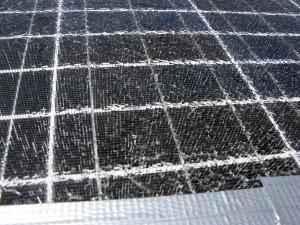 A bandaged solar panel. Many shards of glass!