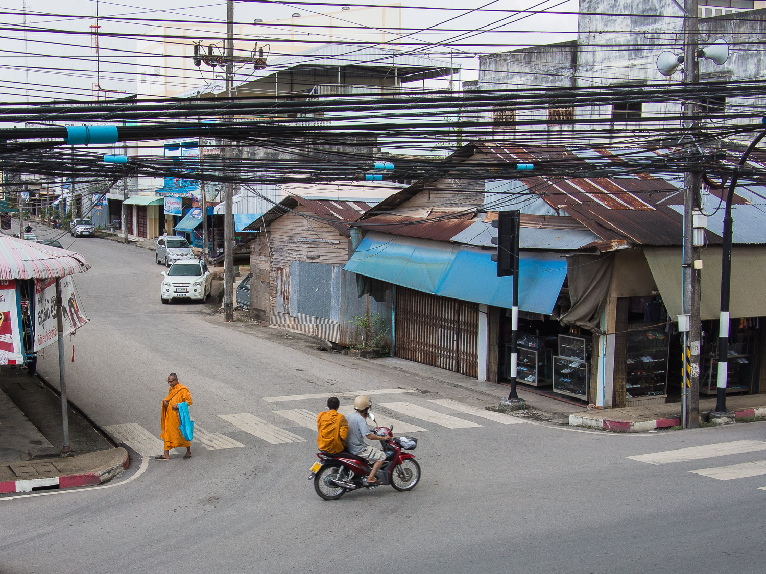 Satun town seen from a bank mall, including a monk from the monastery