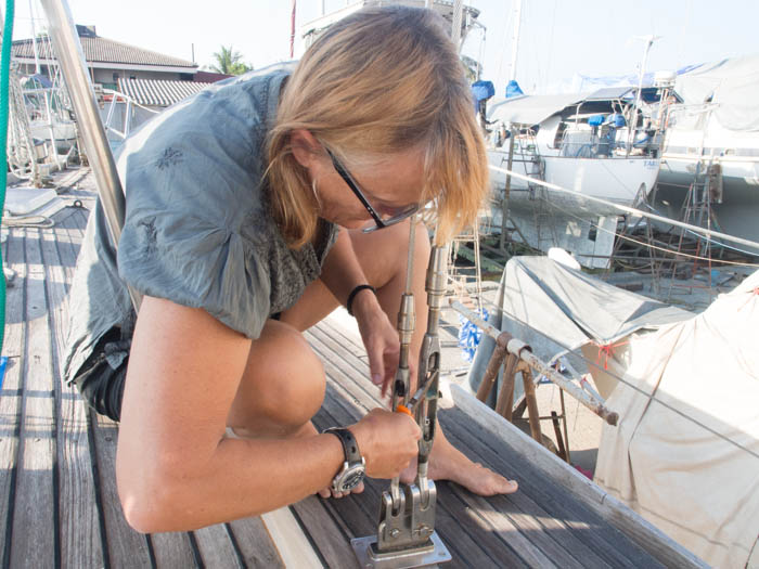 Liz removes the cotter pins from the turn buckles on the mizzen shrouds