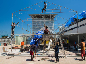 The yard workers at PSS Boatyard Satun erect the tent for our boat