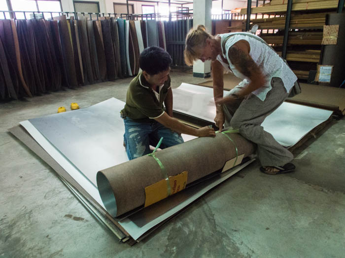 Liz helps roll up the Formica in Hat Yai