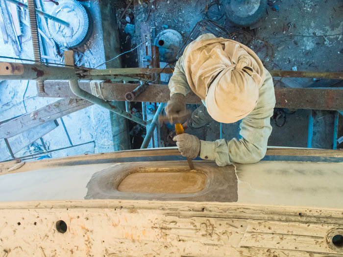 Long-boarding. Sanding the top-sides of the boat