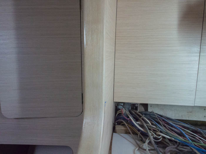 The solid ash, centre, has one coat of polyurethene applied and is a better match with the rest of the veneer