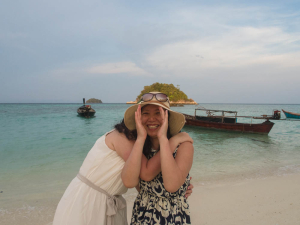 Shy girls in floppy sunhats are ubiquitous in this part of the world