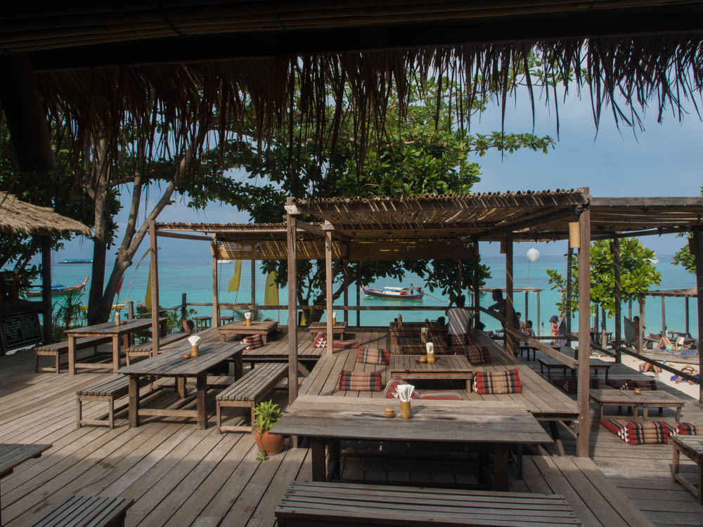 The elevated fdining area of Castaway resort looking out from the bar-cum-library and onto the sea beyond