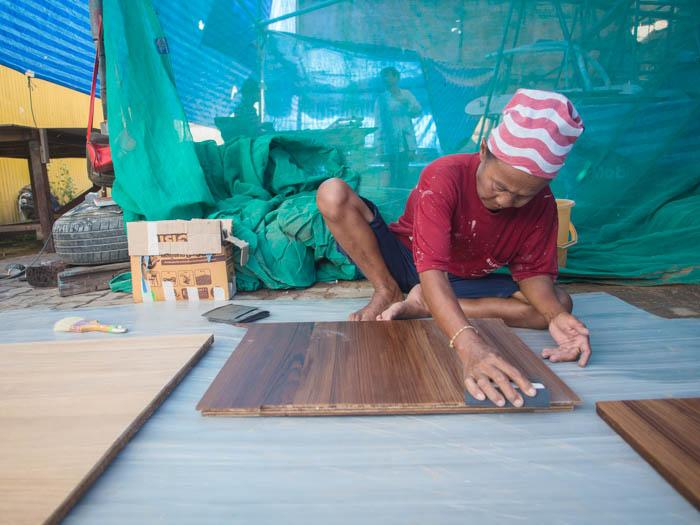 Tongjan faring the teak floorboards