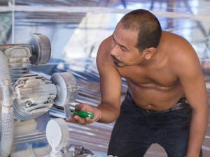 Goy checking the compressor
