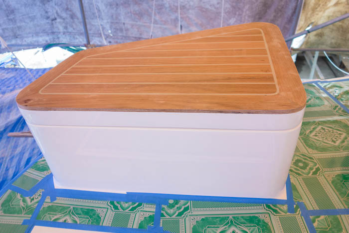 Deck boxes with fitted lids and teak planking for seats