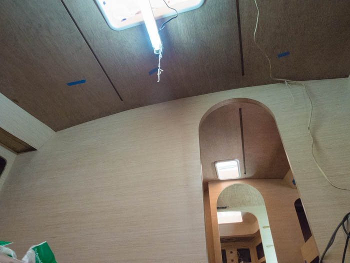 Ply backboards are fitted for the boat's ceiling