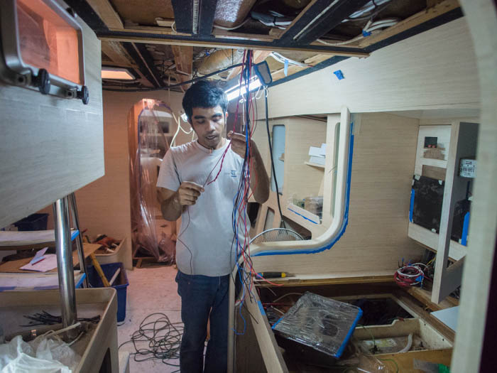 Electricians aboard Esper wire up the saloon LED lights