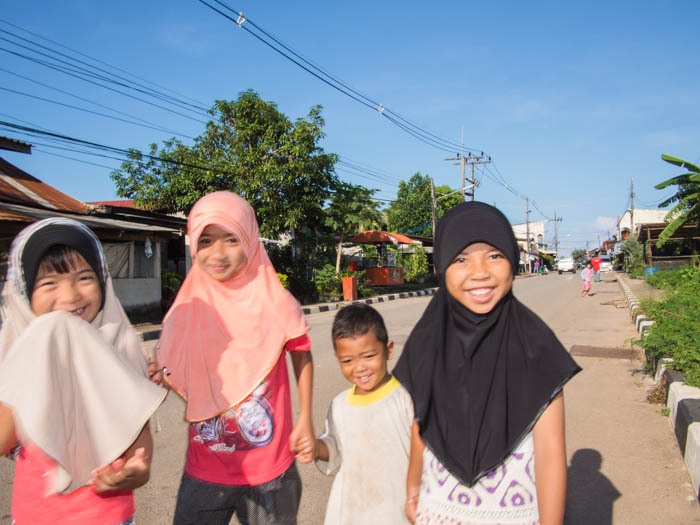 More young people, this time local children on their way to the market