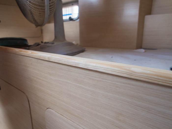 Pine trim matches the white vine interior